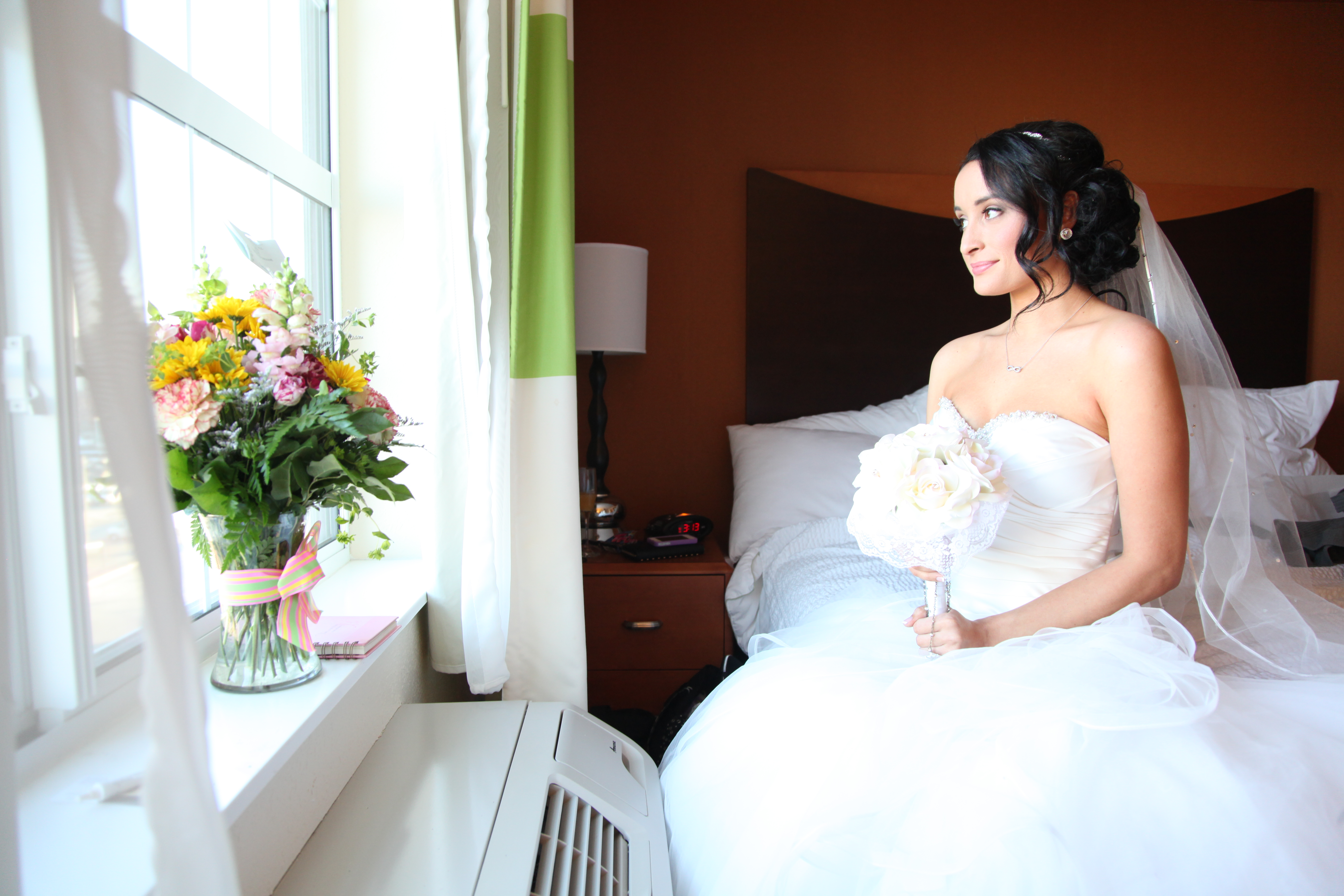 Bride looks out the window