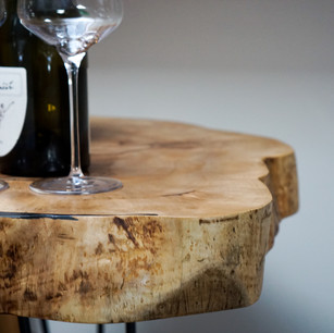 Maple coffee table to sit back and enjoy the wine.