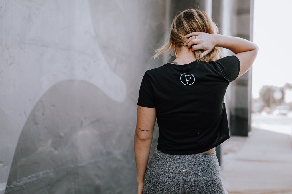 """Black """"All Bodies are Yoga Bodies"""" Cropped Tee (Back)"""