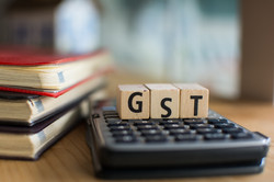 Word of GST spelled with colorful wooden