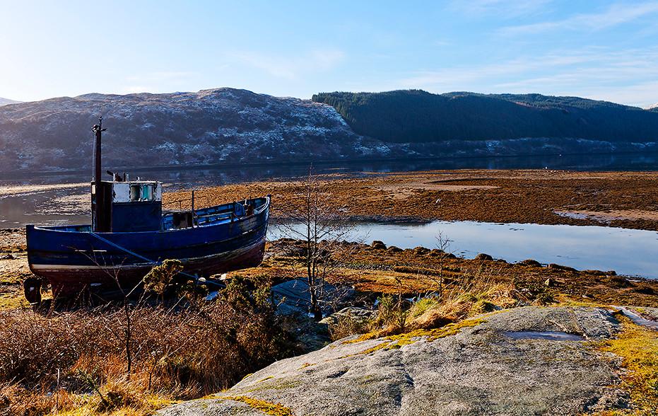 A moored fishing boat. Staring at the horizon as it waits for next fishing season.