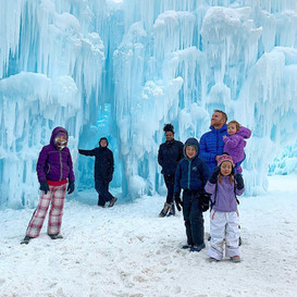 Greg with kids at the ice castles in Midway, Utah