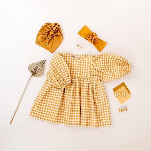 Suknelė pūstomis rankovėmis