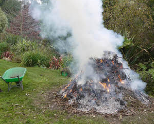 Garden waste burning in garden causing a lot of smoke
