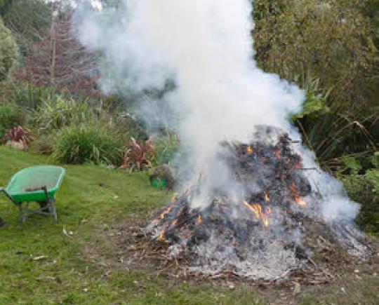 Garden waste burning in garden causing a lot of smoke