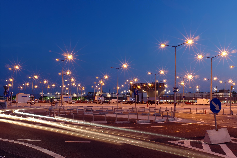 Lanterns at shopping mall parking lot illuminated at night
