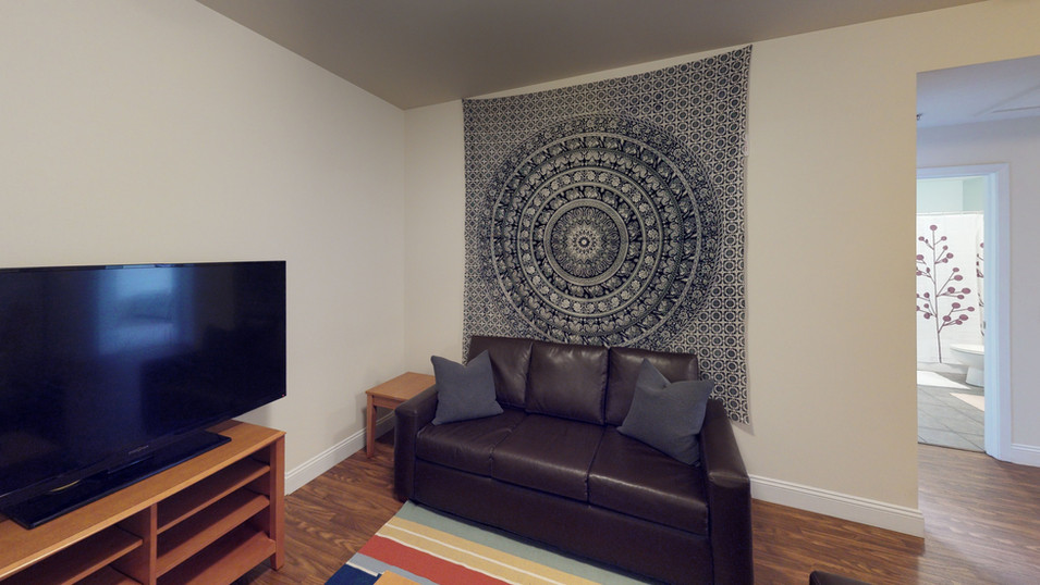 """Schoolhouse Lofts Living Room with 55"""" HDTV"""