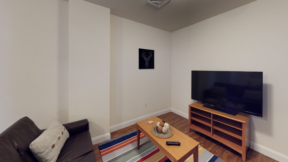 Schoolhouse Lofts Living Room w/ Coffee Table and TV