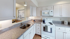 Our modern kitchens come with the latest stainless steel appliances and a microwave!