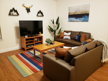 """Every Suite Style Living Room Includes a 55"""" HDTV"""