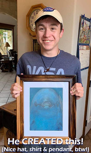 John, 16, loved Book 1! Here he is showing off his painting of a dolphin! It's beautiful!