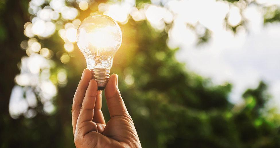 idea solar energy in nature, hand holdin