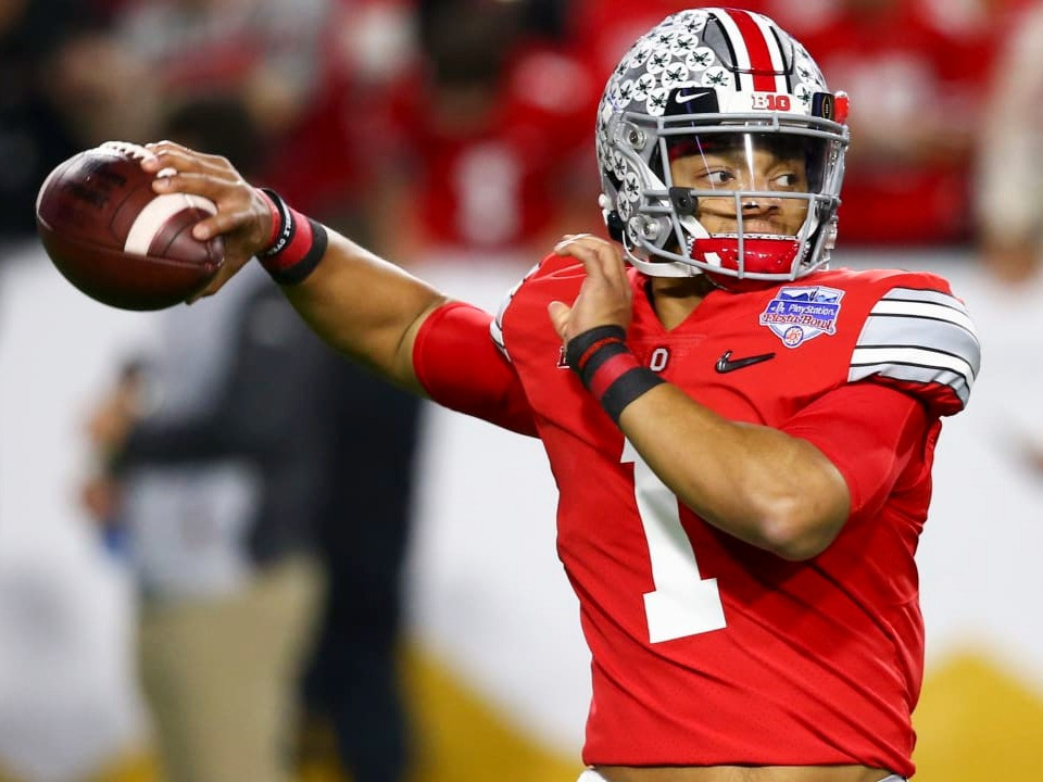 Justin Fields, quarterback for Ohio State is the second pick off the board to the New York Jets in our 2021 NFL Mock Draft.