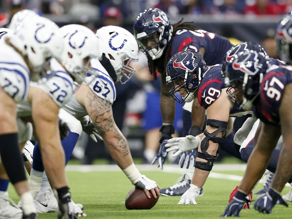 Indianapolis Colts and Houston Texans players line up at the line of scrimmage during a 2020 NFL game