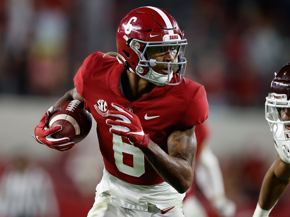 Devonta Smith, wide receiver for Alabama Crimson Tide catches a runs with the football during a college football game in 2020.
