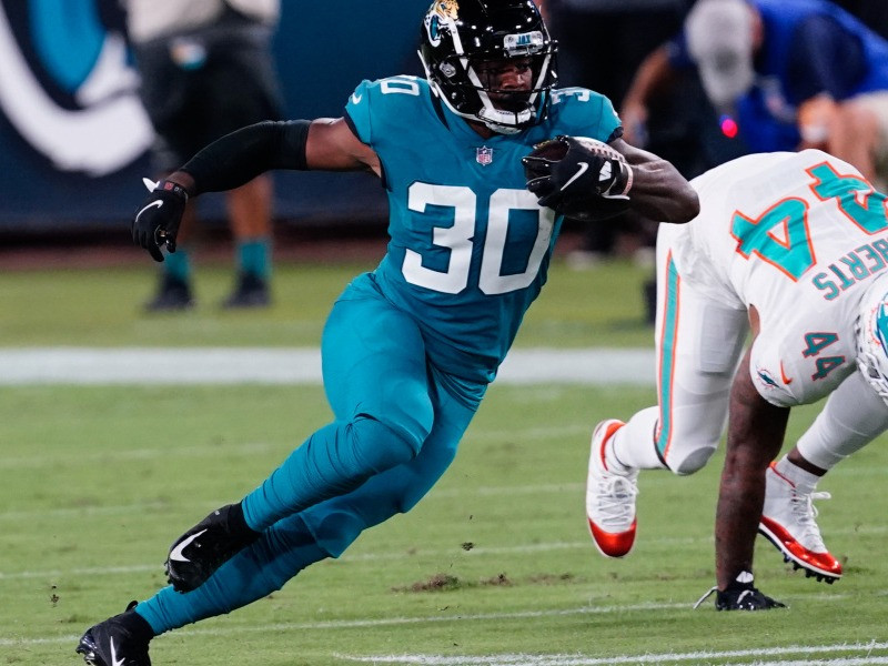 James Robinson of the Jacksonville Jaguars runs the ball during a game against the Miami Dolphins during the 2020 NFL season. Robinson was one of the best players for Jacksonville last season and will hope to be a part of a more successful season in 2021 for the franchise.