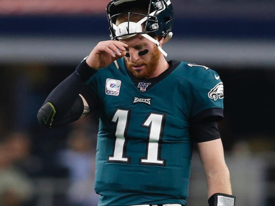 Carson Wentz the quarterback of the Philadelphia Eagles looks downcast as he walks off the field after a disappointing game during the 2020 NFL season