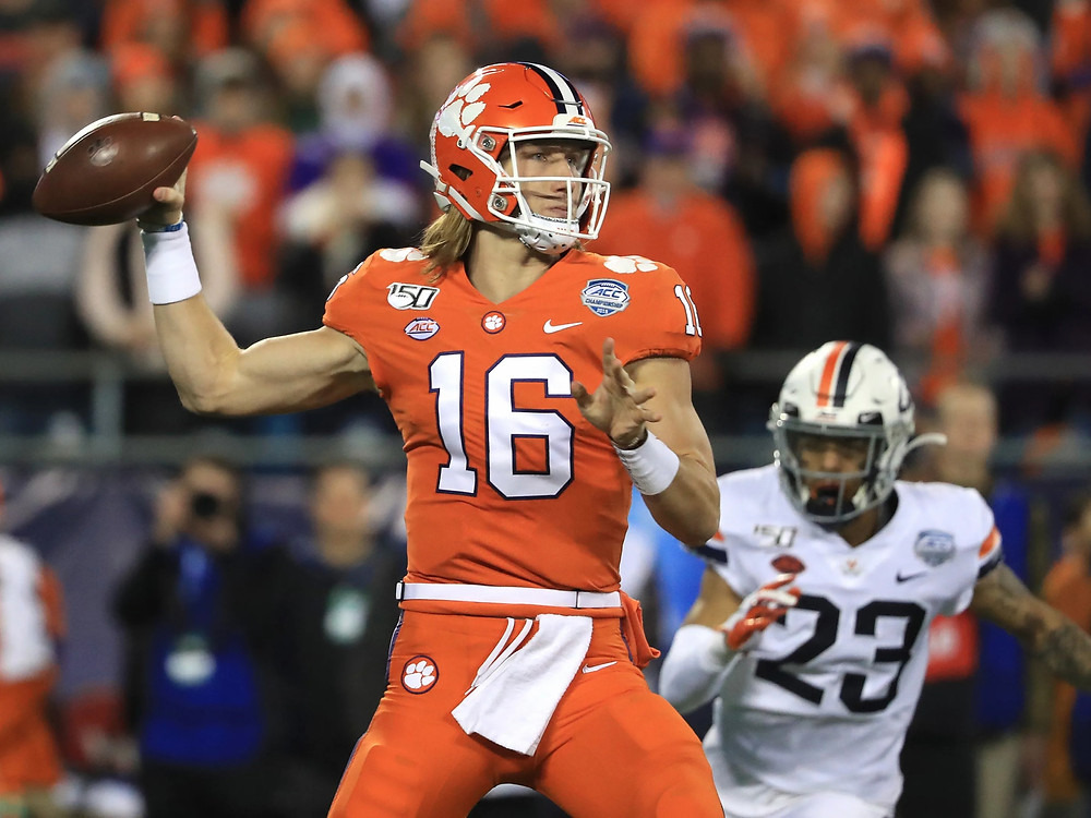Trevor Lawrence, quarterback for Clemson Tigers is likely to become the first overall pick in the 2021 NFL Draft which belongs to the Jacksonville Jaguars. Can he lead a turnaround of fortunes for the Jags? In this picture he is throwing a ball during a College Football game.
