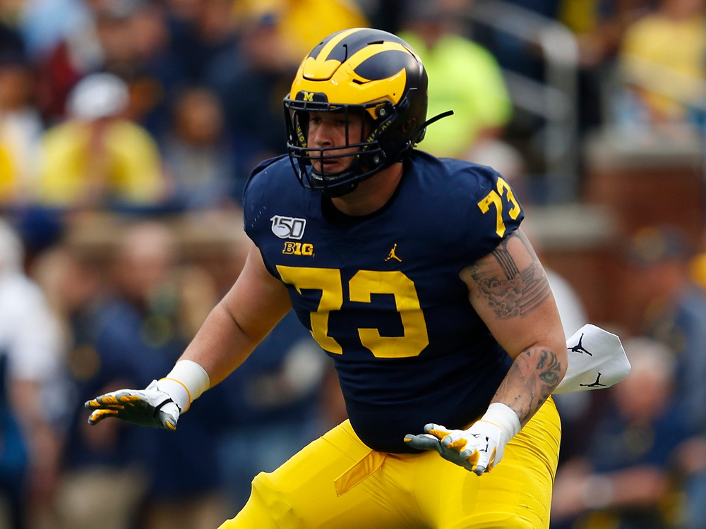 Michigan offensive tackle Jalen Mayfield blocks during a college football game in 2020. We believe he is the sixth best offensive tackle prospect in the 2021 NFL Draft.