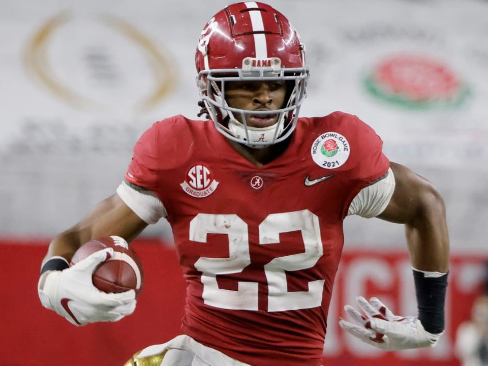 Running back Najee Harris of Alabama Crimson Tide was taken in the first round of the 2021 NFL Draft. He is pictured here playing a college football game in Tuscaloosa, 2021