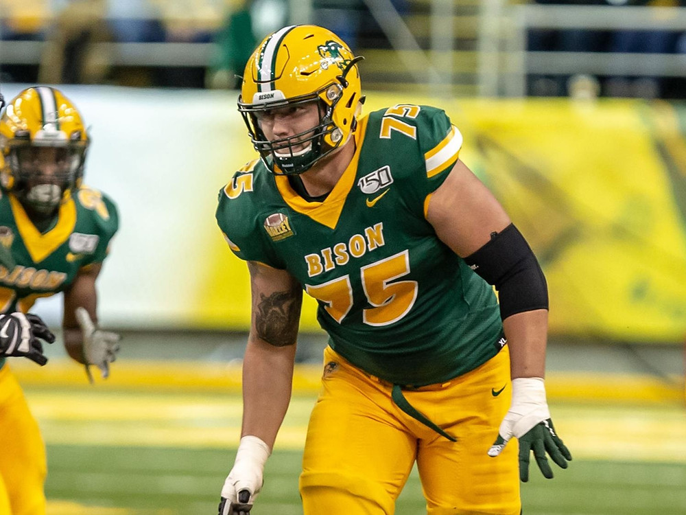 North Dakota State Bison's left tackle, Dillon Radunz blocks during a college football game in 2020. Radunz is our fourth ranked offensive tackle and we believe he should be taken as a first round pick in the 2021 NFL Draft.