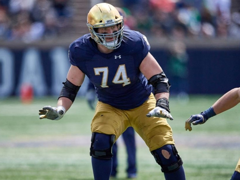 Notre Dame's Liam Eichenberg blocks during a 2020 college football game. Eichenberg is our tenth ranked offensive tackle prospect.