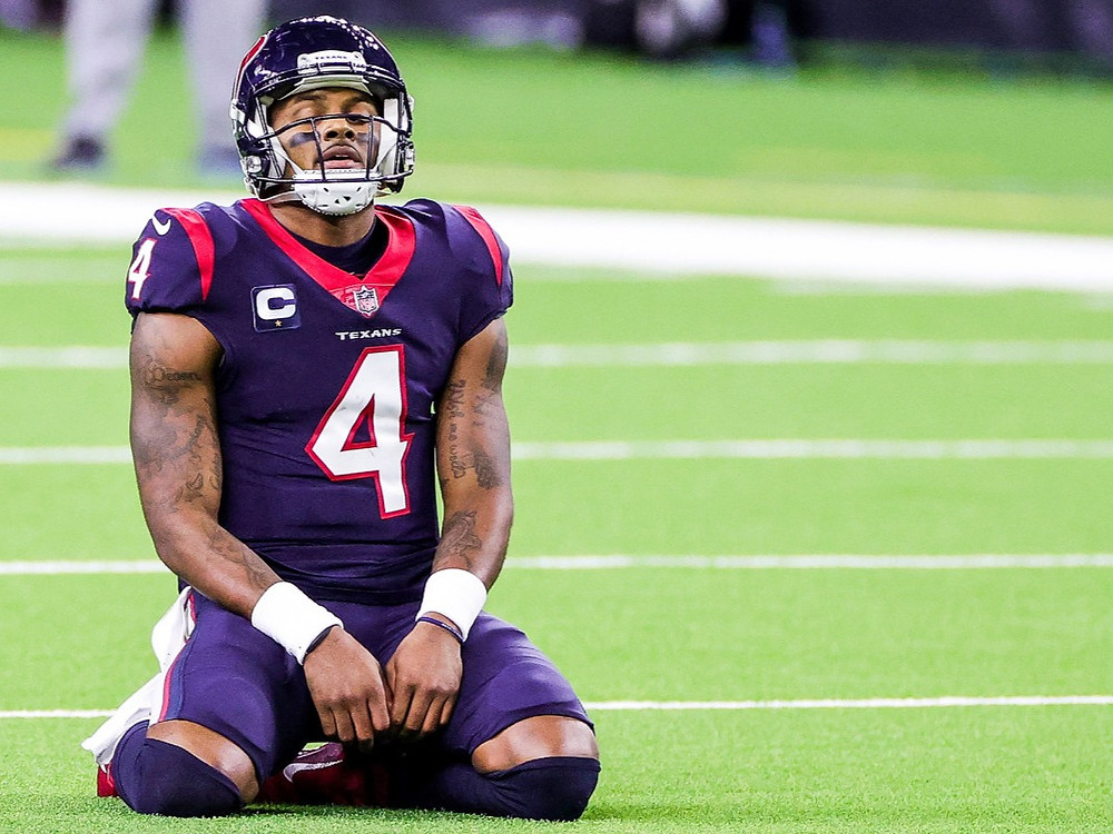 Deshaun Watson of the Houston Texans looks disappointed on the field of play during an NFL game as he contemplates his future in Houston.