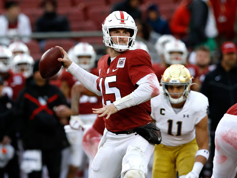 Davis Mills, quarterback for Stanford throws a pass during the 2020 college football season in a game against Notre Dame.