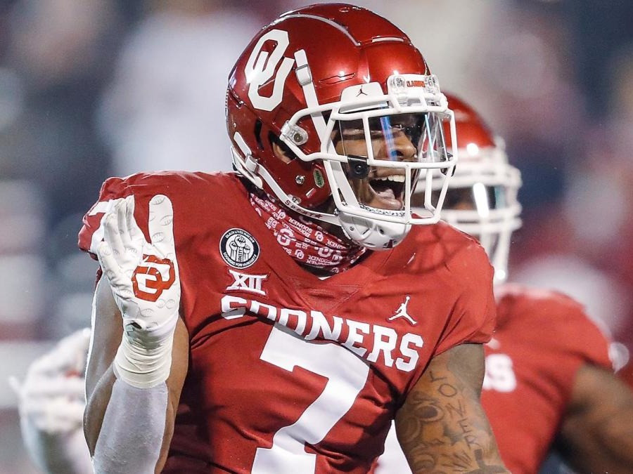 Ronnie Perkins, the Oklahoma Sooners edge prospect celebrates during a college football game in 2020. We look at Perkins' 2021 NFL Draft scouting report today and assess whether he is worth a first round draft pick.