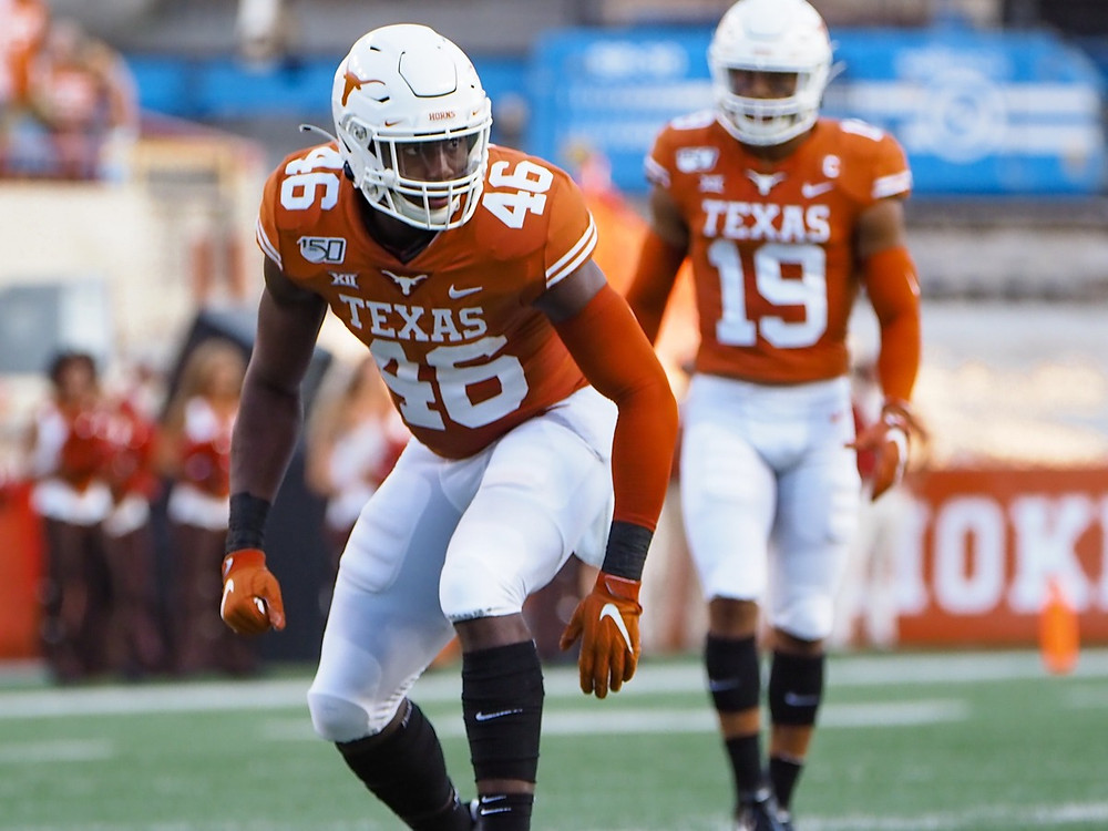 Joseph Ossai of the Texas Longhorns lines up before a play during the 2020 College Football season. Ossai's scouting report suggests that he could be a first round pick in the 2021 NFL Draft