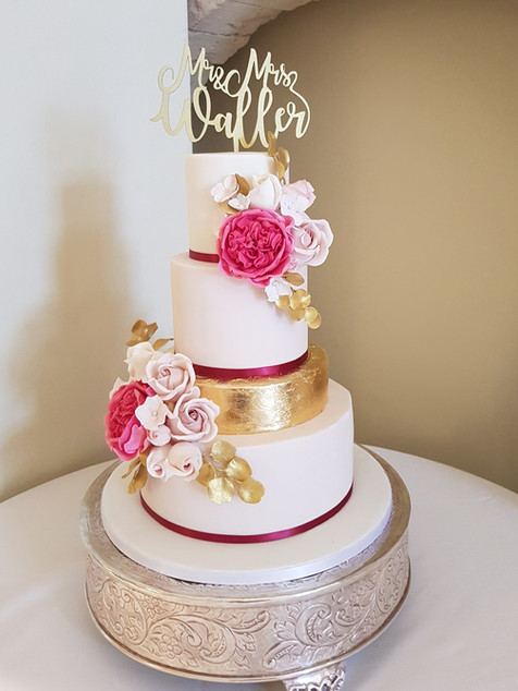 Fucshia and gold wedding cake