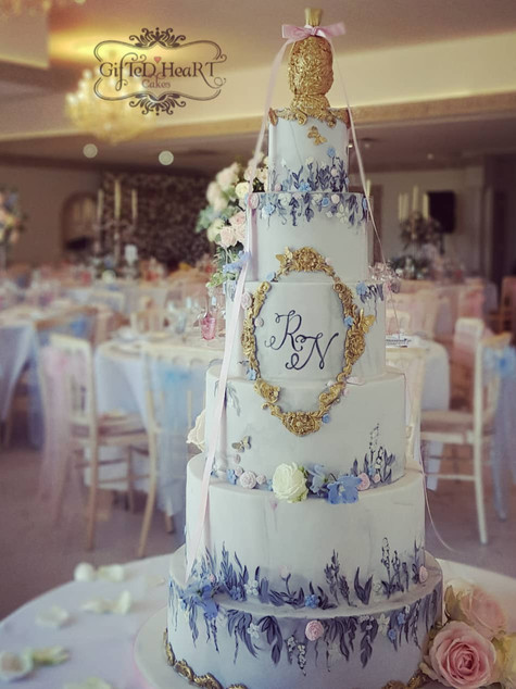 Romantic blue and gold wedding cake
