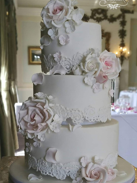 Lace and rose wedding cake