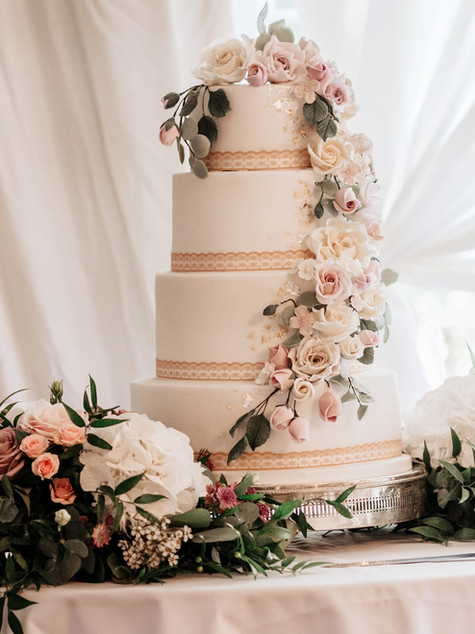 Classic wedding cake with full cascade of sugar flowers