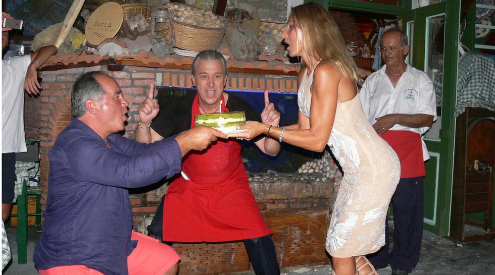 Billionaire Farkhad Akhmedov his wife and Manos at Manos Fish Restaurant Symi Island