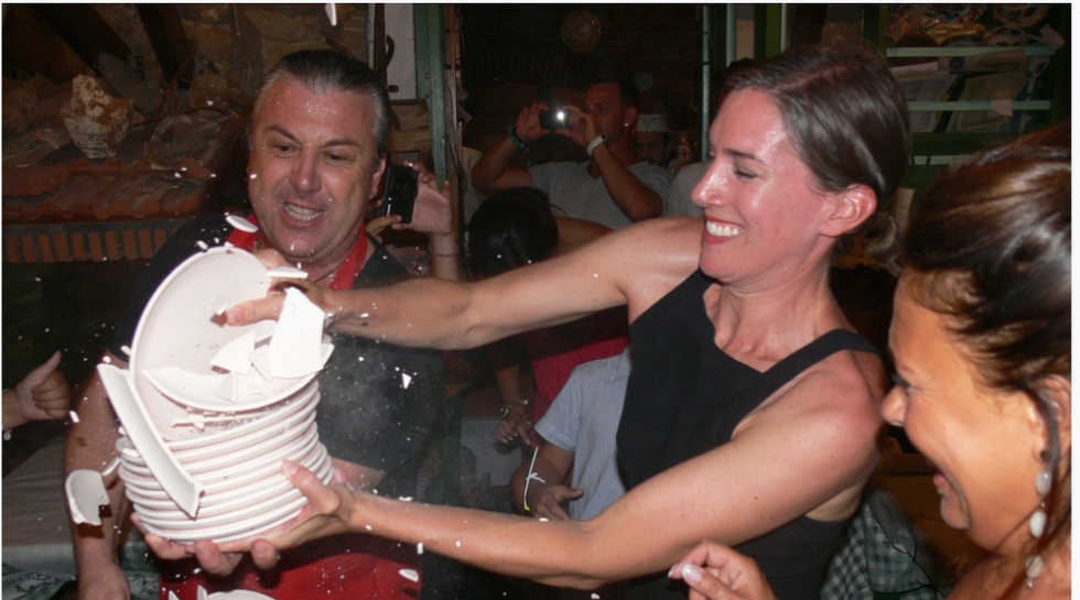 SARAH MORRIS with Manos breaking Plates at Manos Fish Restaurant Symi Island