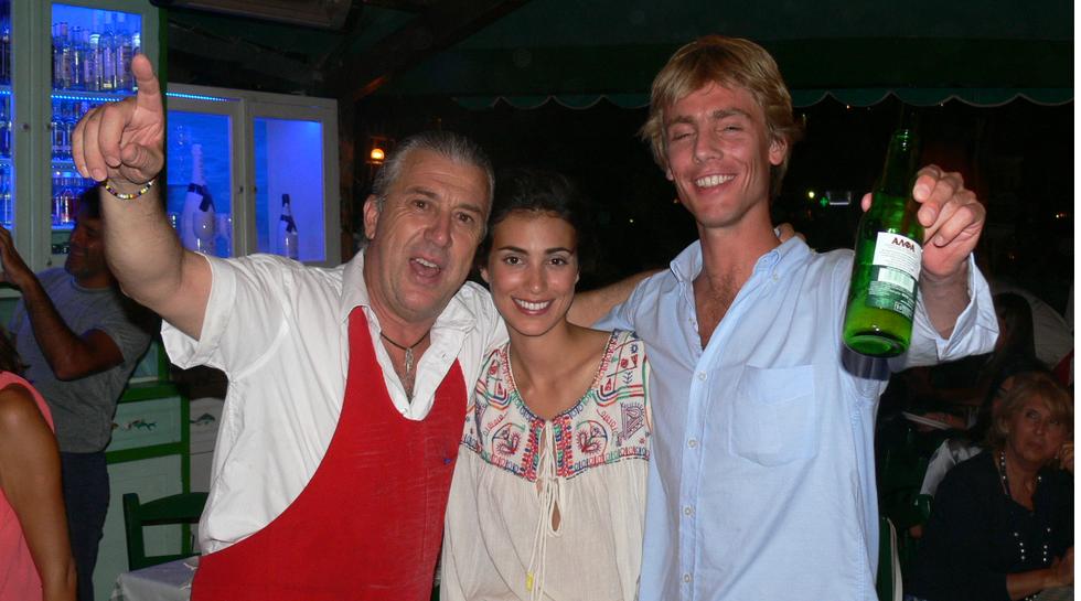 PRINCE  CRISTIAN with wife ALESANDRA DE OSMA and Manos at Manos Fish Restaurant Symi Island