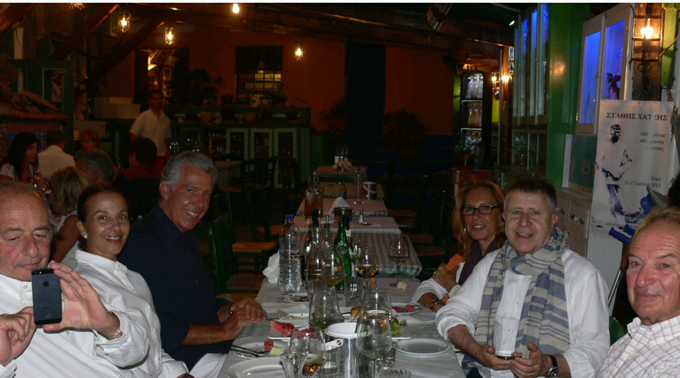 Billionaire Augusto Perfetti with his friends and family at Manos Fish Restaurant Symi Island