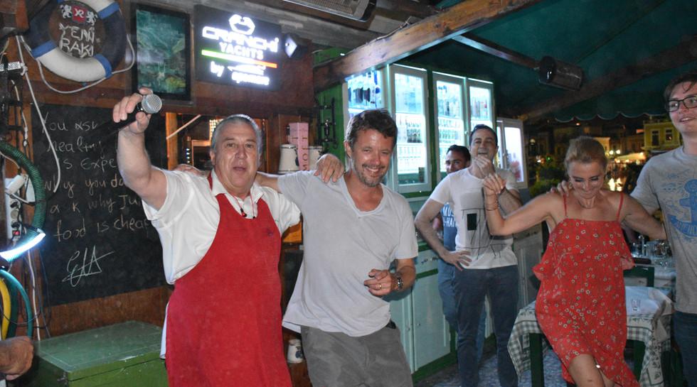 Frederik, Crown Prince of Denmark dancing Sirtaki with Manos at Manos Fish Restaurant Symi Island
