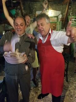 Billionaire Nusli Wadia and Manos Breaking plates at Manos Fish Restaurant Symi Island
