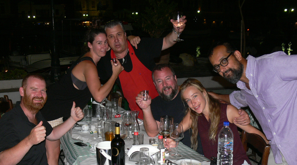 Shane Smith and Suroosh Alvi with theyr families and Manos at Manos Fish Restaurant Symi Island