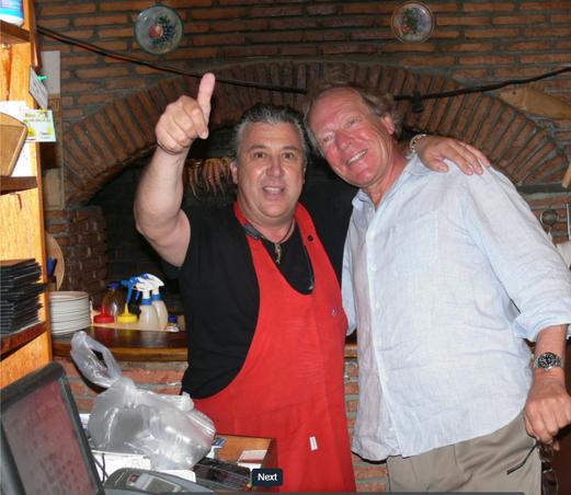 Herbert G. Kloiber and Manos at Manos Fish Restaurant Symi