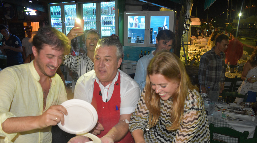 Princess Beatrice breaking plates with Manos at Manos Fish Restaurant Symi Island