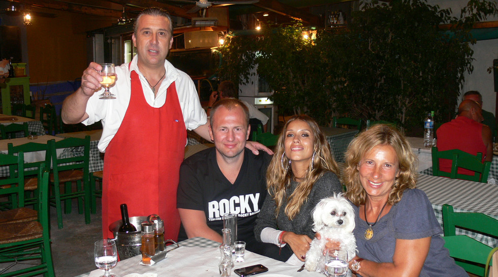 Andrey Melnichenko with his wife and Manos at Manos Fish Restaurant Symi Island