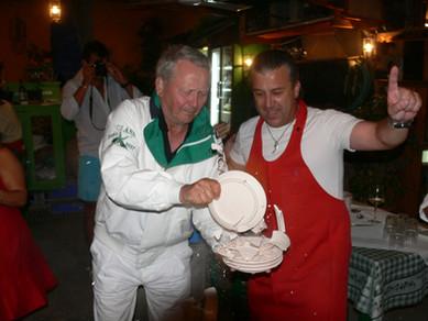 Wolfgang Porsche breaking plates with Manos at Manos Fish Restaurant Symi Island
