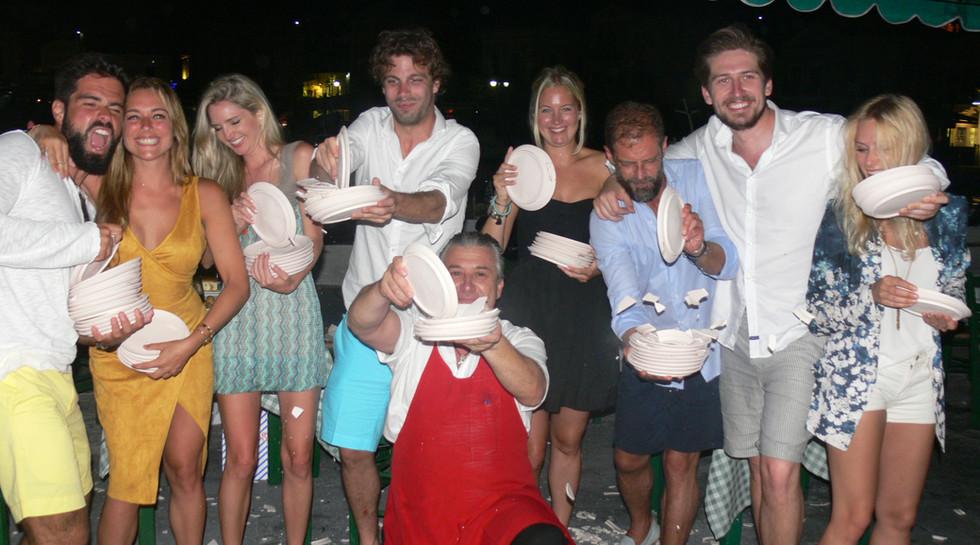 Chandris family breaking plates with Manos at Manos Fish Restaurant in Symi Island