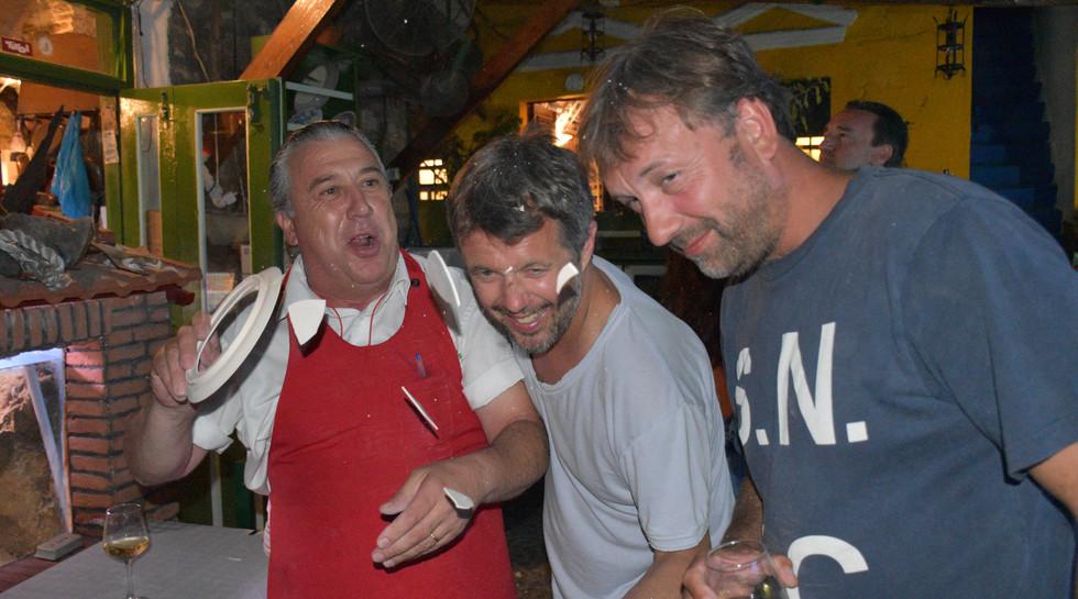Frederik, Crown Prince of Denmark breaking plates with Manos at Manos Fish Restaurant Symi Island