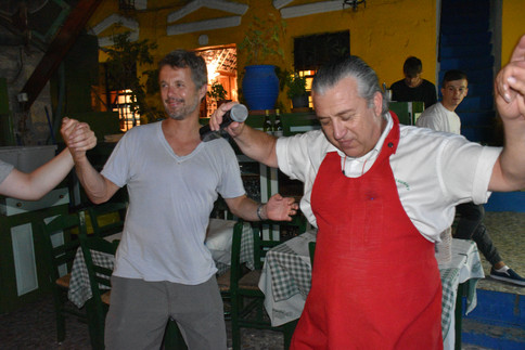 Frederik, Crown Prince of Denmark dancing with Manos at Manos Fish Restaurant Symi Island