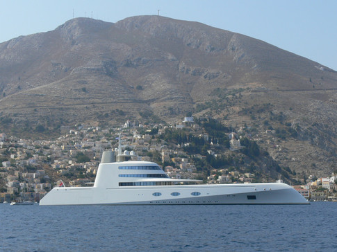 Boat of Andrey Melnichenko and his wife eating at Manos Fish Restaurant Symi Island