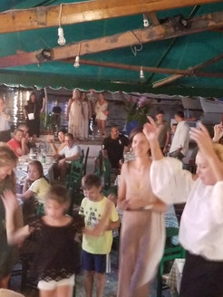 Sam Nazarian and his wife Emina Cunmulaj partying at Manos Fish Restaurant Symi Island